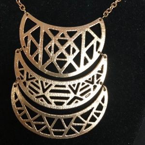 "Statement  ""tribal motif"" necklace"